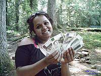 Esha Gordon holds up Berkshare currency. Credit:Matthew Cardinale/IPS