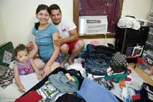 Leonardo Nakao (right) along with his wife, Kelma Rodrigues de Sousa, and daughter, Ketellyn Dliveira de Sousa, pack belongings in their apartment in Norwood, Mass., before flying to Brazil. Leonardo and Kelma immigrated to the United States nine years ago, but have decided to return to Brazil after the recession has left them competing for jobs with Americans. (Mary Knox Merrill/The Christian Science Monitor)