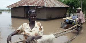 Jane Awuor and Jane Achieng in their flooded homestead in Kojiem village, Nyando on April 1, 2013. They were unsure of their next move after flood waters marooned their home in Kojiem village in Nyando. Deaths and loss of property have been reported as the rains pound parts of the country. Photo/TOM OTIENO