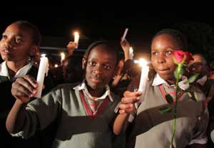 Pupils of Nyeri Good Shepherd school lift candles during prayers and tributes for the Westgate victims outside Raybells restaurant in Nyeri town on September 27, 2013. Photo/JOSEPH KANYI
