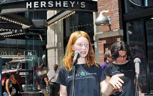 "Marie Hogan speaks at a ""Raise the bar, Hershey!"" rally. Photo from Raise the Bar, Hershey! Marie Hogan. Photo by Diane Greene Lent."