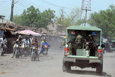 A Joint Military Task Force (JTF) patrolling the streets of the restive northeastern Nigerian town of Maiduguri, Borno State on April 30, 2013. At least 74 people have been killed and scores others injured in two separate attacks in Northeastern Nigeria. PHOTO/AFP