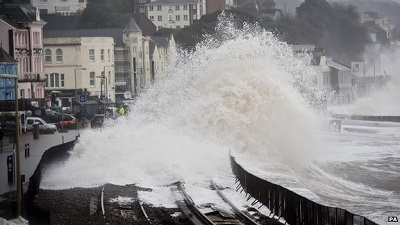 Waves continued to lash the seafront