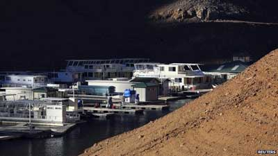 Houseboats docked at Holiday Harbor (23 January 2014) These houseboats lie docked in Shasta Lake, which is 100 feet (30 metres) below its normal levels