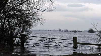 Submerged gate in Burrowbridge, Somerset on 31 January 2014 The Environment Agency has issued flood warnings for many areas