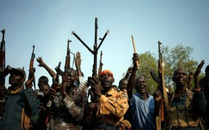 South Sudanese rebel fighters, seen in this file photo from Feb. 8, 2014, gather in a village in Upper Nile State.Goran Tomasevic/Reuters