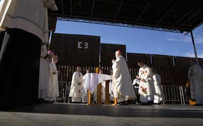 A group of U.S. bishops, led by Cardinal Sean O'Malley of Boston, celebrates Mass at the border fence Tuesday in Nogales, Ariz. (CNS/Nancy Wiechec)