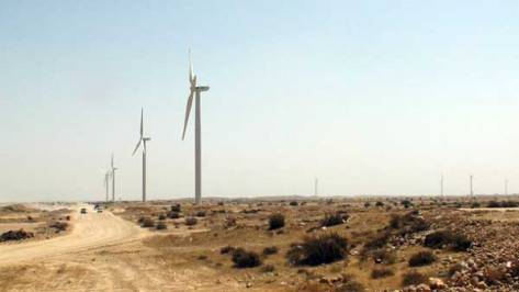 Over a dozen huge windmills line the roadside of the town of Jhimpir, close to Karachi, in the Sindh province. Credit: Farooq Ahmed/IPS