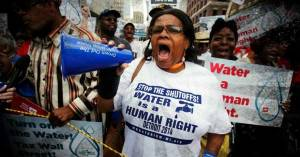 "The people of Detroit have pledged to risk arrest ""in order to protect and uphold the human right to water in Detroit."" (Photo: Detroit Water Brigade)"