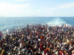 The Italian Navy rescued 1,004 refugees and migrants on 14 August 2014. Some arrived barefoot, some children were shaking with cold. Men, women and children from Syria, Somalia, Gambia, Bangladesh and other countries were rescued. Credit: Amnesty International