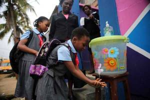 A student washed her hands as classes resumed in Lagos last week.  Credit Akintunde Akinleye/Reuters