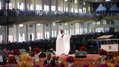 Bishop David Oyedepo, founder of the Living Faith Church, conducts a service recently in his auditorium in the Ota district about 60km outside Lagos. (Akintunde Akinleye, Reuters)