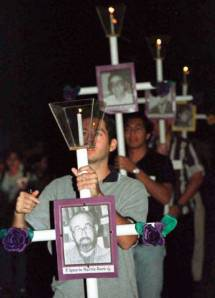 REMEMBERING IN HOPE. Members of Christian communities participate in a procession outside the Central American University in San Salvador, Nov. 15, 1999, as they observe the tenth anniversary of the massacre of six Jesuit priests, their housekeeper and her teenage daughter.