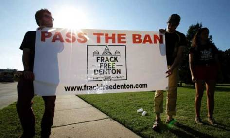 In this 15 July 2014 file photo, anti-fracking protesters hold a campaign sign outside city hall, in Denton, Texas. Photograph: Tony Gutierrez/AP