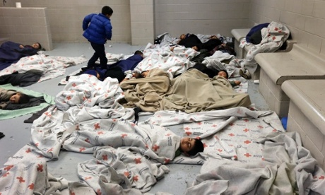 Children sleep in a holding cell at a US Customs and Border Protection processing facility in Texas. Photograph: Eric Gay/AP