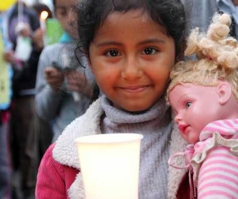 Ruby Arazabel, 6, takes part in a Nov. 30 vigil for climate change on the eve of the U.N. climate summit in Lima, Peru. (CNS/Barbara Fraser)