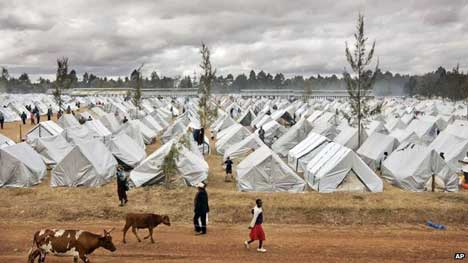 A sea of tents made out of plastic sheeting fills a camp for the displaced in the showground in Eldoret, Kenya (19 January 2008). About 600,000 people were forced to flee their homes in the post-election violence