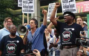 Activists, including actor Mark Ruffalo, union members, and Detroit residents streamed through downtown Detroit on July 18, 2014, protesting the controversial water shutoffs and calling for local democracy and economic justice. Photo from Unitarian Universalist Service Committee.