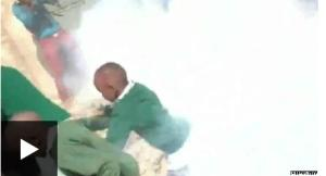 Footage shows children smothered in tear gas, as the BBC's Ed Thomas reports