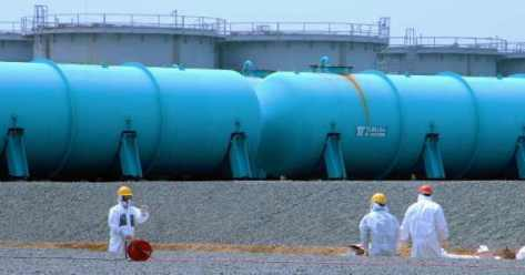 Workers at TEPCO's Fukushima Daiichi Nuclear Power Station work among underground water storage pools in April, 2013. Two types of above-ground storage tanks rise in the background.(Photo: IAEA Imagebank/flickr/cc)