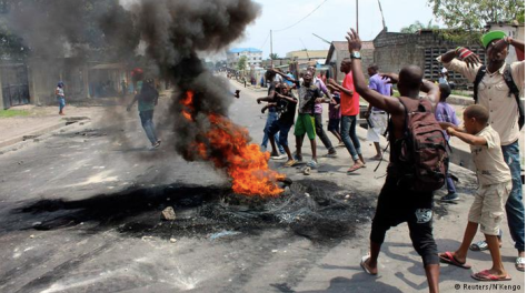 Demonstrators burn tyres in the DR Congo capital Kinshasa. Violent protests in January were against Kabila's attempt to prolong his presidency
