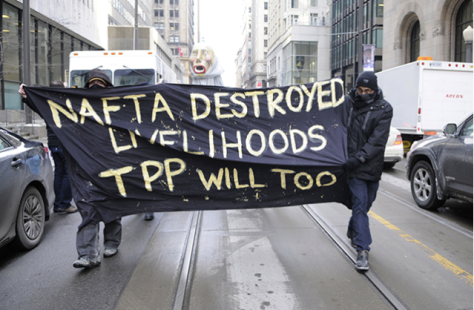 Protesters in Toronto demonstrate against the Trans-Pacific Partnership deal under consideration by President Obama and many other world leaders with moneyed interests on January 31, 2014. (Photo: arindambanerjee / Shutterstock.com)