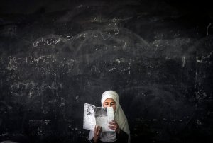 An Afghan girl at school in Parwan Province. Credit Sergey Ponomarev for The New York Times