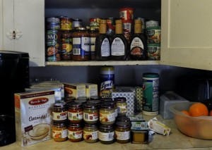 The actual contents of a Rhode Island woman's cupboard after two shopping trips paid for with food stamps. (Michael S. Williamson/The Washington Post)