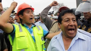 Members of the National Federation of Metallurgical, Mining, Iron and Steel industries of Peru shout slogans as they march towards the Congress in Lima on Tuesday, May 19.