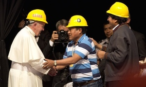Pope Francis shakes hands with a mining worker's leader watched by Bolivia's president Evo Morales, right, in Santa Cruz, Bolivia. Photograph: Rodrigo Abd/AP