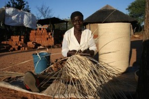 Siduduzile Nyoni, a mother of three, busily completing one of her ilala palm products, which will be sold through a women's cooperative in western Zimbabwe. Credit: Busani Bafana/IPS