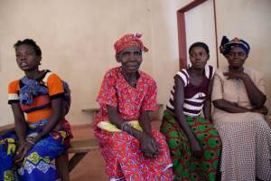 Rontina Alesi Muke, 66, (C) sits inside a village church with other residents of Shinengene, or Southern Settlement, in Zambia's North Western province, 09 August, 2015. THOMSON REUTERS FOUNDATION/Magdalena Mis