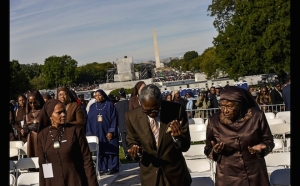 "Attendees are led in prayer at a rally convened by Nation of Islam leader Louis Farrakhan and billed as ""Justice or Else"" to mark the 20th anniversary of the Million Man March on the National Mall in Washington, Oct. 10, 2015. The original Million Man March took place on Oct. 16, 1995. (Reuters/James Lawler Duggan)"