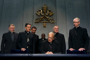 Cardinal Oswald Gracias (c.) signs an appeal next to Cardinal Ruben Salazar Gomez (2nd l.) during a news conference at the Vatican, Monday. Roman Catholic leaders from around the world on Monday made a joint appeal to a forthcoming United Nations conference on climate change to produce a 'fair, legally binding and truly transformational' agreement. Alessandro Bianchi/Reuters