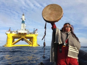 You Shell not pass: First Nations activist and singer Audrey Siegl confronts the oil giant's drilling rig on its way to the Arctic. © Emily Hunter / Greenpeace