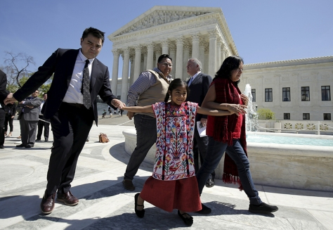 Sophie, walks with her father, Raul Cruz, after arguments in a challenge over the constitutionality of President Obama's executive action to defer deportation of certain immigrants, in Washington