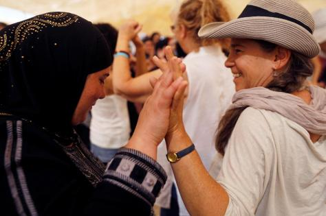 "Women celebrate inside a ""peace tent"" erected as part of an event organised by ""Women Wage Peace"" group calling for an end to the Israeli-Palestinian conflict, near the Jordan River, in the occupied West Bank"