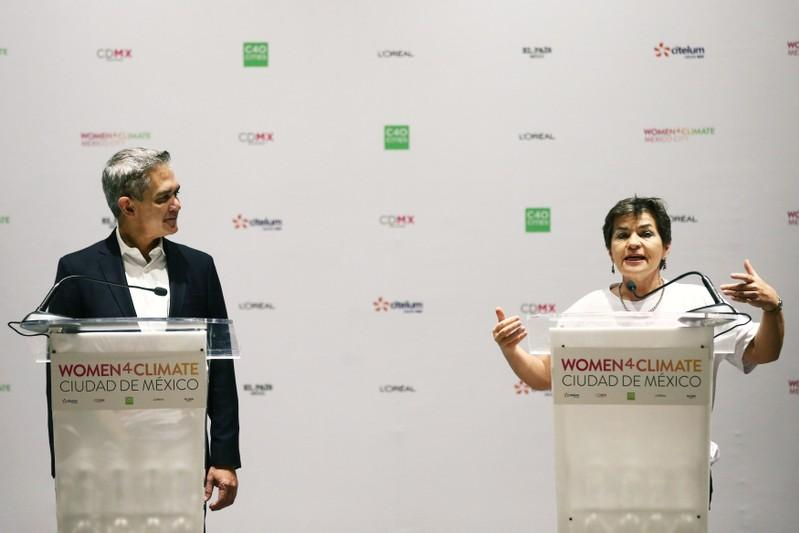 Christiana Figueres, former Executive Secretary of United Nations Framework Convention on Climate Change, speaks next to Mexico City Mayor Miguel Angel Mancera during a news conference within the framework 2018 Women4Climate Summit in Mexico City
